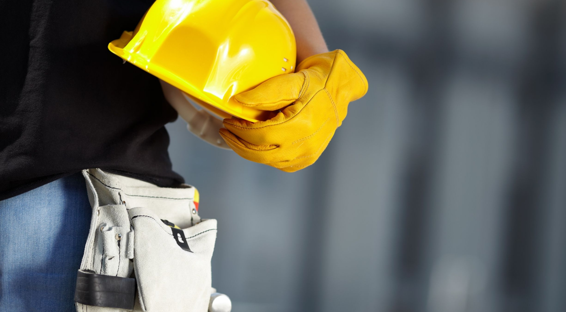 8075165 – builder with yellow helmet and working gloves on building site
